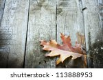 Autumn Leaf On Wooden Boards...