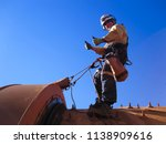 industrial rope access fitters  ... | Shutterstock . vector #1138909616