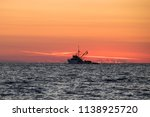 ship in sunset on the adriatic... | Shutterstock . vector #1138925720