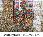 color popcorn in the window... | Shutterstock . vector #1138928174