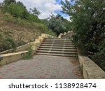 the long staircase descends... | Shutterstock . vector #1138928474