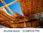 the hole in the straw roof and...   Shutterstock . vector #1138933790