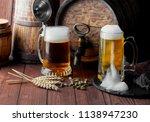 light foam beer in a glass on... | Shutterstock . vector #1138947230