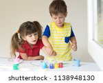 kilds playing at home or... | Shutterstock . vector #1138948130
