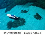 aerial view of a yacht on an... | Shutterstock . vector #1138973636