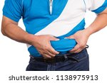Small photo of Man pinching own unhealthy big belly with visceral or subcutaneous fats. Pose health risk.