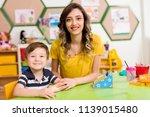 preschooler and teacher in... | Shutterstock . vector #1139015480