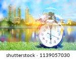 double exposure of alarm clock...   Shutterstock . vector #1139057030