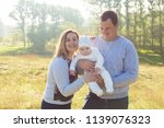 happy family with the child in... | Shutterstock . vector #1139076323