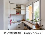 white tiny modern kitchen with...   Shutterstock . vector #1139077133