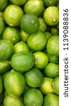 lots of bright green limes in... | Shutterstock . vector #1139088836