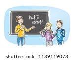 happy female teacher  standing... | Shutterstock .eps vector #1139119073