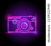 camera neon logo. glow in the...