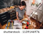 woman renovating kitchen and... | Shutterstock . vector #1139146976