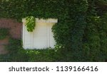 white shutters on weathered... | Shutterstock . vector #1139166416