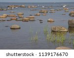stones rush on the see shore. | Shutterstock . vector #1139176670