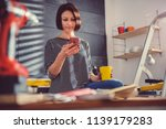 woman sitting on ladder and... | Shutterstock . vector #1139179283