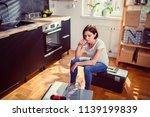 worried woman sitting on a... | Shutterstock . vector #1139199839