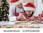 cheerful mature grandmother is...   Shutterstock . vector #1139226620