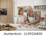 happy girl is enjoying baking... | Shutterstock . vector #1139226830