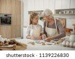happy girl is enjoying baking... | Shutterstock . vector #1139226830