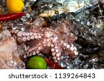 fresh seafood lined in ice with ... | Shutterstock . vector #1139264843