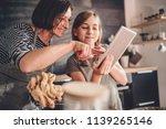 mother and daughter standing in ... | Shutterstock . vector #1139265146