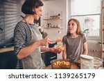 mother and daughter tasting... | Shutterstock . vector #1139265179