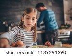 girl having breakfast at home... | Shutterstock . vector #1139291390