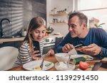 daughter showing text message... | Shutterstock . vector #1139291450