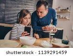 daughter showing text message... | Shutterstock . vector #1139291459