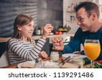 father and daughter having... | Shutterstock . vector #1139291486