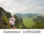 young woman tourist with... | Shutterstock . vector #1139312600