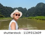 young woman traveling by boat... | Shutterstock . vector #1139312609