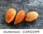 almond on wooden background | Shutterstock . vector #1139322599