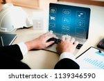 it staff sitting on the laptop. | Shutterstock . vector #1139346590