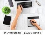 graphic designer using laptop... | Shutterstock . vector #1139348456