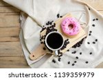 coffee cup and donut with... | Shutterstock . vector #1139359979