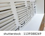 Stock photo metal and stainless steel handle styles on wooden kitchen cabinet with different stainless steel 1139388269