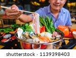enjoy eating shabu shabu and... | Shutterstock . vector #1139398403
