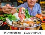 enjoy eating shabu shabu and... | Shutterstock . vector #1139398406