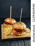 homemade juicy burgers on... | Shutterstock . vector #1139404940