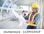 aged engineer looking at... | Shutterstock . vector #1139415419