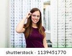 beautiful teenage girl choosing ...   Shutterstock . vector #1139451770