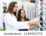 beautiful teenage girl choosing ...   Shutterstock . vector #1139451773