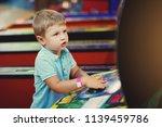 cute boy in blue t shirt plays... | Shutterstock . vector #1139459786