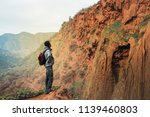 man on a trip in the mountains. | Shutterstock . vector #1139460803