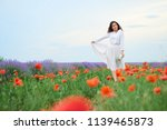 young woman is in the lavender... | Shutterstock . vector #1139465873