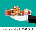 tray with fast food in hand of... | Shutterstock . vector #1139472419