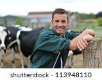 Herdsman Standing In Front Of...